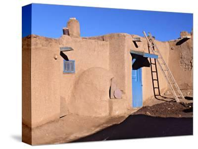 Pueblo House with Blue Door and Oven, Taos, New Mexico, USA