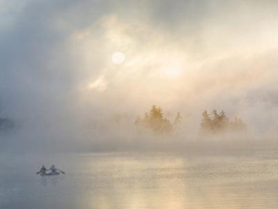 Two Canoers Paddling, Cranberry Lake, Adirondack State Park, New York, USA by Charles Sleicher