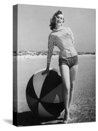 Windswept Young Lady Wearing Shorts and a Stripey Dolman