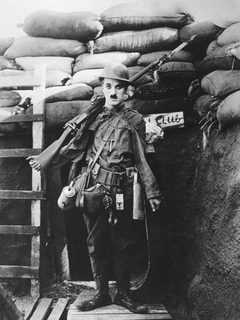 https://imgc.artprintimages.com/img/print/charlie-chaplin-shoulder-arms-1918_u-l-q10t7bj0.jpg?p=0