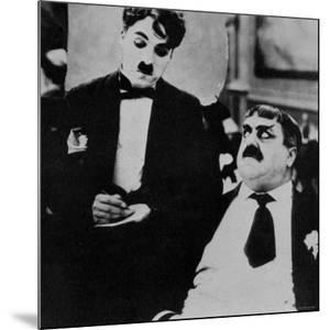 Charlie Chaplin with Eric Campbell in The Rink