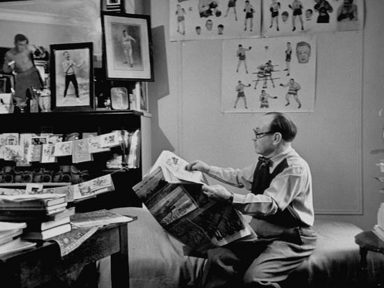 Charlie Goldman in His Room Reading the Newspaper--Photographic Print