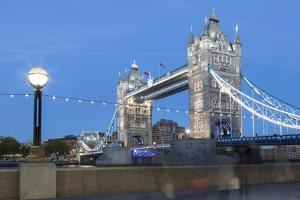Tourists and Passers by Stop to Take Pictures of Tower Bridge at Dusk by Charlie Harding