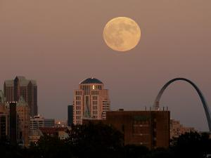 A Full Moon Rises Behind Downtown Saint Louis Buildings and the Gateway Arch Friday by Charlie Riedel
