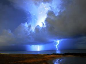 Lightning on Beach in Mexico by Chasethesonphotography