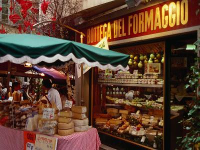 Cheese Stall Outside Cheese Shop on Via Pessina, Lugano, Ticino, Switzerland-Stephen Saks-Photographic Print