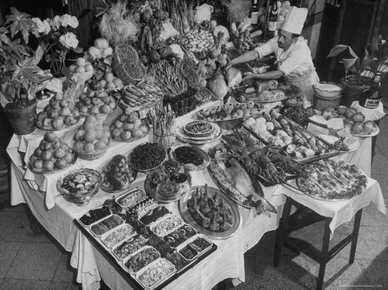 Chef Domenico Giving Final Touch to Magnificent Display of Food on Table at Passeto Restaurant-Alfred Eisenstaedt-Photographic Print