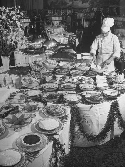 Chef Preparing Dish at Buffet Table in Dining Room of the Waldorf Astoria Hotel-Alfred Eisenstaedt-Photographic Print