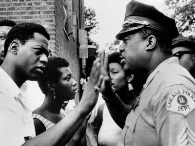 Chicago African American Policeman Tries to Calm a Crowd--Photo