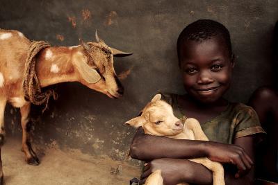 Child Holding a Kid-Mauro Fermariello-Photographic Print