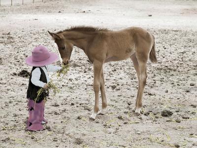 Child in Western Wear Feeding a Pony-Nora Hernandez-Giclee Print