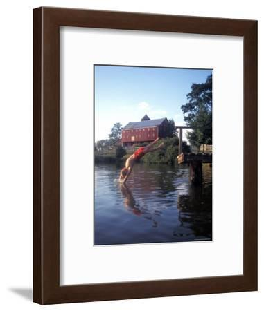 Child Jumps into a Pond on a Farm in Comus, Maryland-Richard Nowitz-Framed Photographic Print