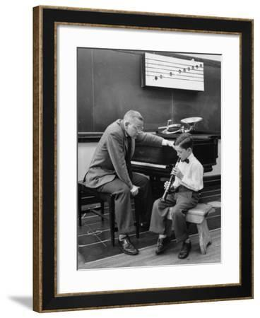 Child Playing Various Musical Instruments-Nina Leen-Framed Photographic Print