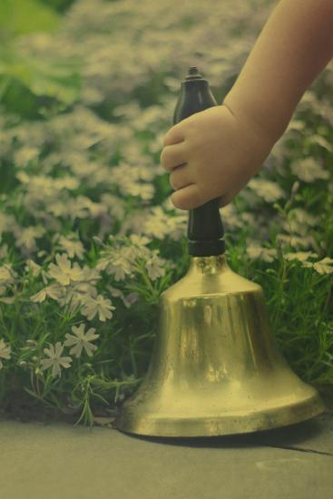 Child's Hand Holding Bell-Elizabeth Urqhurt-Photographic Print