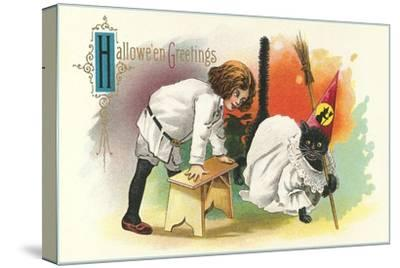 Child with Black Cat in Costume