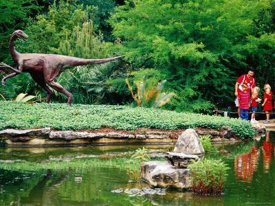 Children and Adult Standing near Ornithomimus Dinosaur Sculpture, Austin, Texas-Richard Cummins-Photographic Print