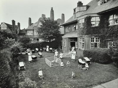 Children and Carers in a Garden, Hampstead, London, 1960--Photographic Print