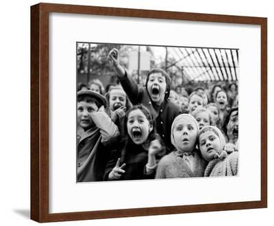 Children at a Puppet Theatre, Paris, 1963-Alfred Eisenstaedt-Framed Premium Photographic Print