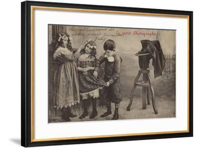 Children Beside a Camera--Framed Photographic Print