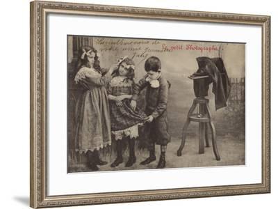 Children Beside a Camera--Framed Photographic Print