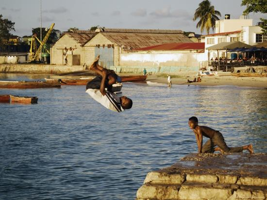 Children Diving in Sea at Waterfront, Stone Town, Zanzibar Town, Zanzibar West, Tanzania-Ariadne Van Zandbergen-Photographic Print