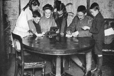 https://imgc.artprintimages.com/img/print/children-emptying-their-money-boxes-to-invest-in-war-bonds-1936_u-l-ptx49x0.jpg?p=0
