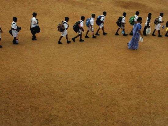 Children Follow Their Teacher as They Head Back to School for the First Time after the Tsunami--Photographic Print