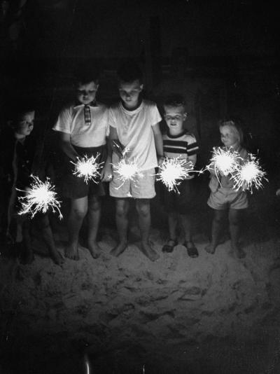 Children Holding Sparklers on a Beach-Lisa Larsen-Photographic Print
