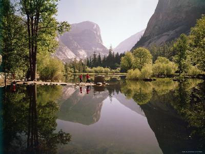 Children on Rocks on Mirror Lake in Yosemite National Park with Mountain Rising in the Background-Ralph Crane-Photographic Print