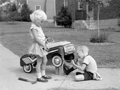 Children on Suburban Sidewalk, Boy Playing As Mechanic, Oiling Toy Pedal Car-H^ Armstrong Roberts-Photographic Print