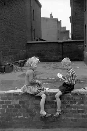 https://imgc.artprintimages.com/img/print/children-play-cards-in-a-shabby-backyard-in-bytom-1956_u-l-q1e4d990.jpg?p=0
