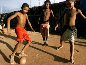 Children Play Soccer at a Shelter in the City Maraba