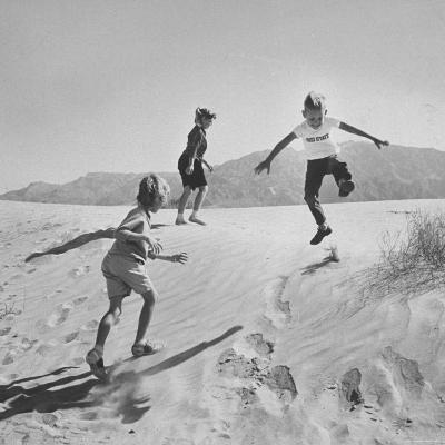 Children Playing in the Desert Sand-Nat Farbman-Photographic Print