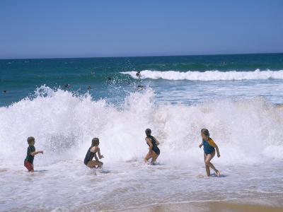 Children Playing in the Surf, Near Gosford, New South Wales, Australia-Ken Wilson-Photographic Print