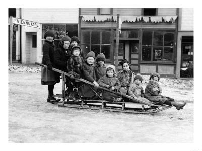 Children Playing on Sleigh in Seward, Alaska Photograph - Seward, AK-Lantern Press-Art Print