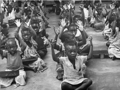 Children Raising their Hands in the Air During Kipuchi Kindergarten Classes-Dmitri Kessel-Photographic Print