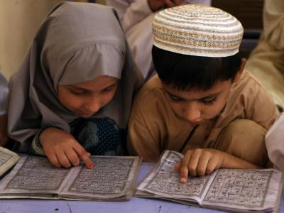 Children read together from muslim s holy quran in karachi
