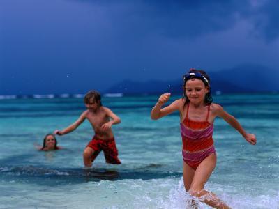 Children Running Out of Ocean in Stormy Weather, Seychelles-Philip & Karen Smith-Photographic Print