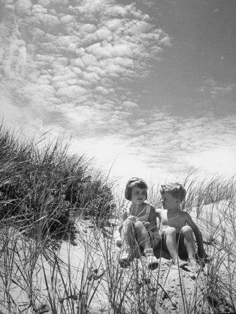 https://imgc.artprintimages.com/img/print/children-sitting-on-a-sand-dune_u-l-p3mu2x0.jpg?p=0