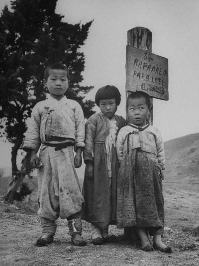 Children Standing in Front of Boundary Zone Sign Written in Russian, English, and Korean-John Florea-Photographic Print