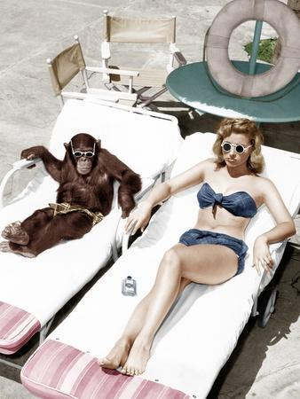 https://imgc.artprintimages.com/img/print/chimpanzee-and-a-woman-sunbathing_u-l-q1bw3ai0.jpg?p=0