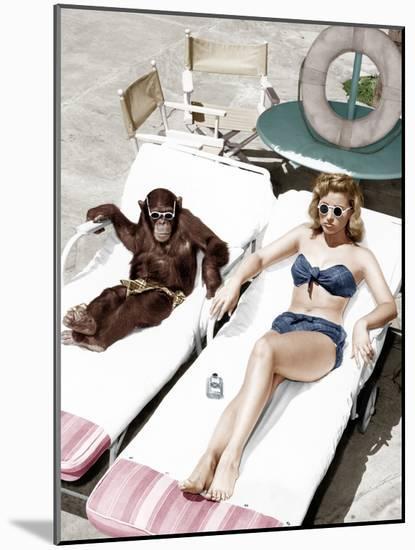 Chimpanzee and a Woman Sunbathing-null-Mounted Photo