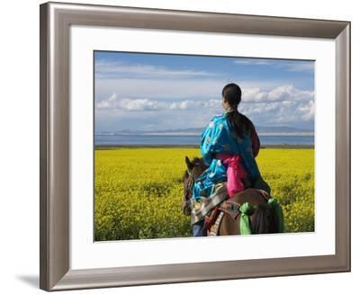 China, Qinghai Province, Tibetan Girl Riding on Horse in the Canola Field Near Qinghai Lake-Keren Su-Framed Photographic Print