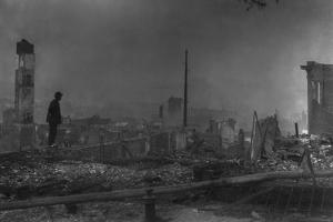 Chinese-American Man Against the Ruins of San Francisco's Chinatown. April 1906
