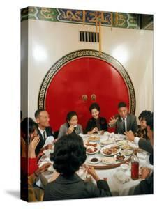 Chinese Family During Dinner at a Traditonally Decorated Restaurant