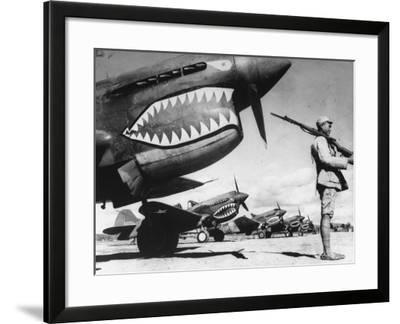 """Chinese Soldier Guarding American P40 Fighter Planes, Emblem of """"Fighting Tigers""""--Framed Photographic Print"""