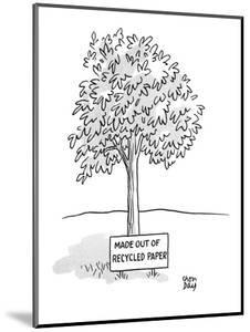 A tree stand with a sign that reads 'Made Out Of Recycled Paper.' - New Yorker Cartoon by Chon Day