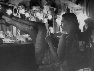 Chorus Girl-Singer Linda Lombard, Resting Her Legs after a Tough Night on Stage-George Silk-Photographic Print