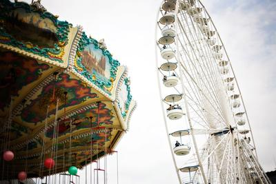 A Swing Ride and a Ferris Wheel in Paris, France