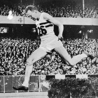 Chris Brasher Takes the Water Jump in the Final of the 3000 Metre Steeplechase--Photographic Print